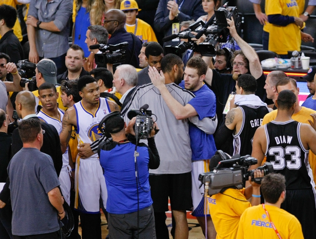 May 16, 2013; Oakland, CA, USA; San Antonio Spurs power forward Tim Duncan (21) hugs Golden State Warriors power forward David Lee (10) after Spurs win over the Warriors for game six of the second round of the 2013 NBA Playoffs at Oracle Arena.  The San Antonio Spurs defeated the Golden State Warriors 94-82 to win the series. Mandatory Credit: Kelley L Cox-USA TODAY Sports