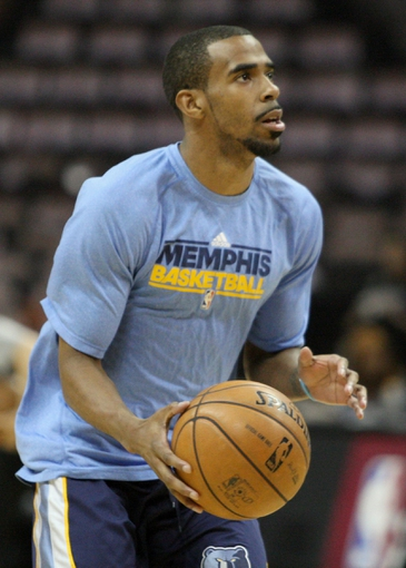 May 19, 2013; San Antonio, TX, USA; Memphis Grizzlies point guard Mike Conley (11) warms up before game one of the Western Conference finals of the 2013 NBA Playoffs against the San Antonio Spurs at AT&T Center. Mandatory Credit: Troy Taormina-USA TODAY Sports