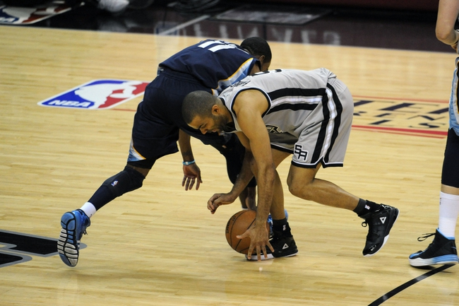 May 19, 2013; San Antonio, TX, USA; San Antonio Spurs guard Tony Parker (9) steals the ball from Memphis Grizzlies guard Mike Conley (11) in game one of the Western Conference finals of the 2013 NBA Playoffs at AT&T Center. Mandatory Credit: Brendan Maloney-USA TODAY Sports