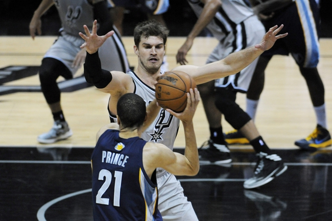 May 19, 2013; San Antonio, TX, USA; San Antonio Spurs center Tiago Splitter (22) defends against Memphis Grizzlies forward Tayshaun Prince (21) in game one of the Western Conference finals of the 2013 NBA Playoffs at AT&T Center. Mandatory Credit: Brendan Maloney-USA TODAY Sports
