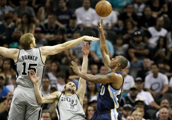May 19, 2013; San Antonio, TX, USA; Memphis Grizzlies power forward Darrell Arthur (00) attempts a shot during the first quarter as San Antonio Spurs shooting guard Manu Ginobili (20) and forward Matt Bonner (15) defend in game one of the Western Conference finals of the 2013 NBA Playoffs at AT&T Center. Mandatory Credit: Troy Taormina-USA TODAY Sports