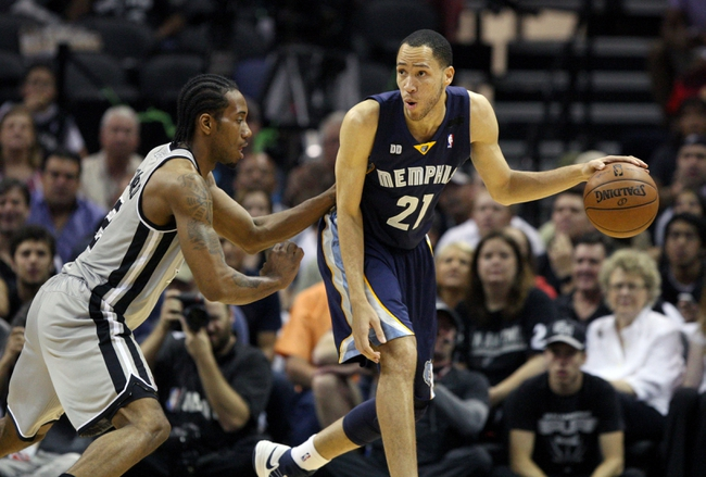 May 19, 2013; San Antonio, TX, USA; Memphis Grizzlies small forward Tayshaun Prince (21) controls the ball during the first quarter as San Antonio Spurs small forward Kawhi Leonard (2) defends  in game one of the Western Conference finals of the 2013 NBA Playoffs at AT&T Center. Mandatory Credit: Troy Taormina-USA TODAY Sports