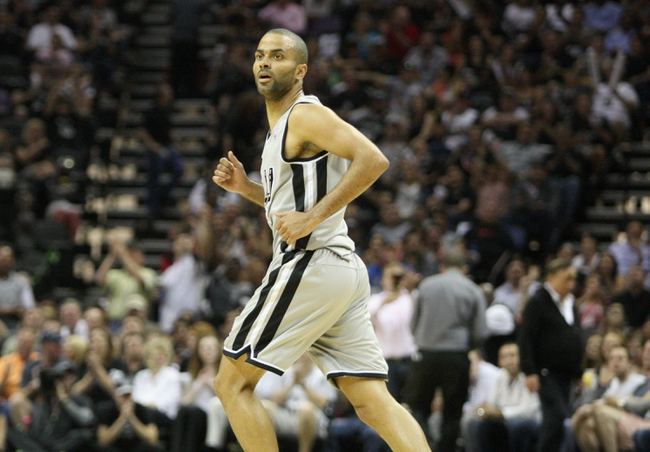 May 19, 2013; San Antonio, TX, USA; San Antonio Spurs point guard Tony Parker (9) reacts after a play during the first quarter against the Memphis Grizzlies in game one of the Western Conference finals of the 2013 NBA Playoffs at AT&T Center. Mandatory Credit: Troy Taormina-USA TODAY Sports