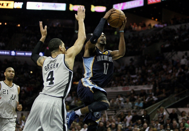 May 19, 2013; San Antonio, TX, USA; Memphis Grizzlies point guard Mike Conley (11) drives to the basket during the third quarter as San Antonio Spurs shooting guard Danny Green (4) defends in game one of the Western Conference finals of the 2013 NBA Playoffs at AT&T Center. Mandatory Credit: Troy Taormina-USA TODAY Sports