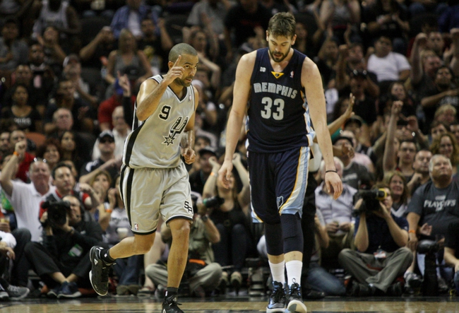May 19, 2013; San Antonio, TX, USA; San Antonio Spurs point guard Tony Parker (9) and Memphis Grizzlies center Marc Gasol (33) react after a play during the third quarter in game one of the Western Conference finals of the 2013 NBA Playoffs at AT&T Center. Mandatory Credit: Troy Taormina-USA TODAY Sports