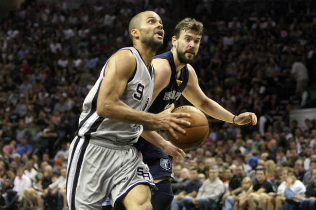 May 19, 2013; San Antonio, TX, USA; San Antonio Spurs point guard Tony Parker (9) drives to the basket during the second quarter as Memphis Grizzlies center Marc Gasol (33) defends in game one of the Western Conference finals of the 2013 NBA Playoffs at AT&T Center. Mandatory Credit: Troy Taormina-USA TODAY Sports