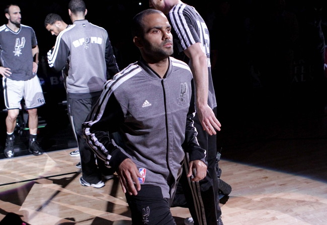 May 19, 2013; San Antonio, TX, USA; San Antonio Spurs point guard Tony Parker (9) is introduced before game one of the Western Conference finals of the 2013 NBA Playoffs against the Memphis Grizzlies at AT&T Center. Mandatory Credit: Troy Taormina-USA TODAY Sports