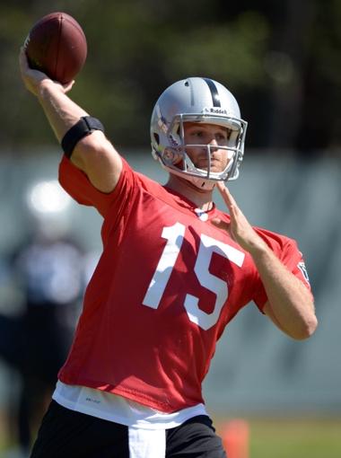 May 20, 2013; Alameda, CA, USA; Oakland Raiders quarterback Matt Flynn (15) throws a pass at organized team activities at the Raiders practice facility. Mandatory Credit: Kirby Lee-USA TODAY Sports