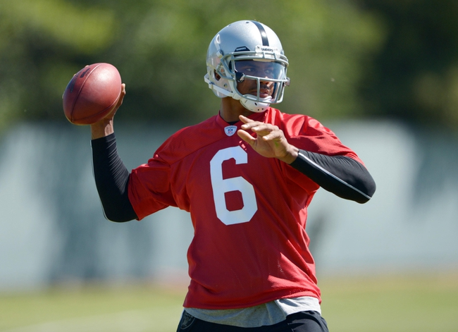 May 20, 2013; Alameda, CA, USA; Oakland Raiders quarterback Terrelle Pryor (6) throws a pass at organized team activities at the Raiders practice facility. Mandatory Credit: Kirby Lee-USA TODAY Sports
