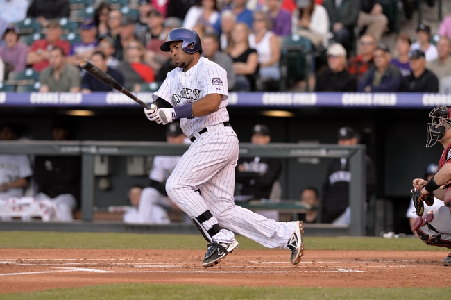 May 21, 2013; Denver, CO, USA; Colorado Rockies catcher Wilin Rosario (20) runs after a single base hit in the second inning against the Arizona Diamondbacks at Coors Field. Mandatory Credit: Ron Chenoy-USA TODAY Sports