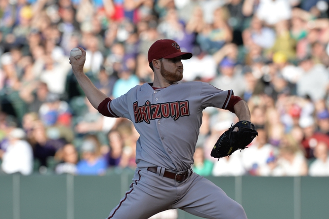 May 21, 2013; Denver, CO, USA; Arizona Diamondbacks starting pitcher Ian Kennedy (31) delivers a pitch against the Colorado Rockies in the first inning at Coors Field. Mandatory Credit: Ron Chenoy-USA TODAY Sports