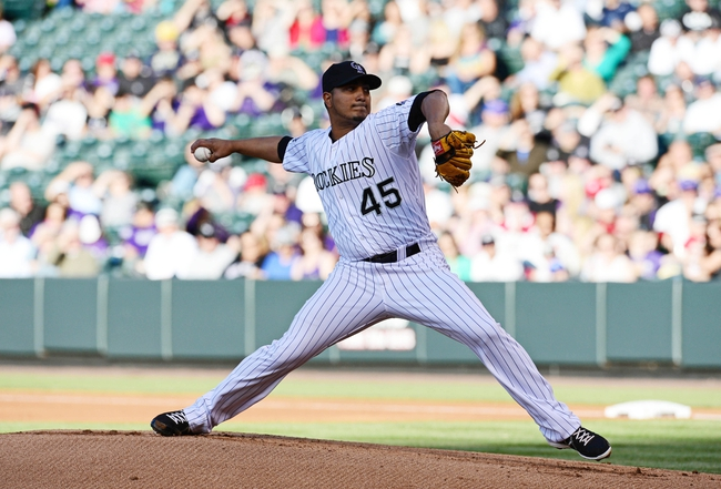 May 21, 2013; Denver, CO, USA; Colorado Rockies starting pitcher Jhoulys Chacin (45) delivers a pitch in the first inning against the Arizona Diamondbacks at Coors Field. Mandatory Credit: Ron Chenoy-USA TODAY Sports
