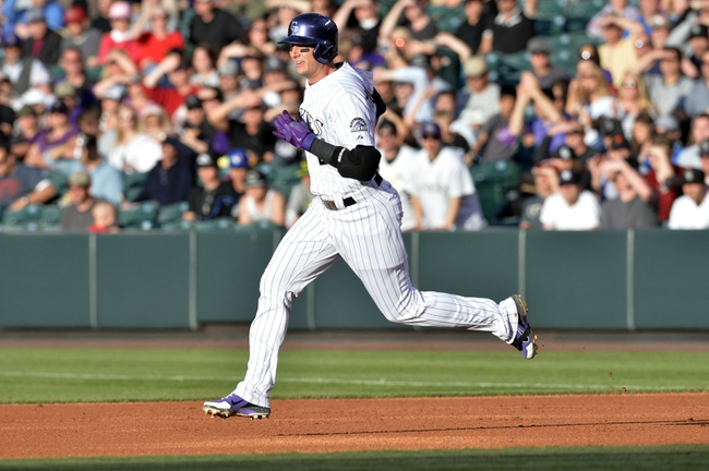May 21, 2013; Denver, CO, USA; Colorado Rockies shortstop Troy Tulowitzki (2) runs after his double base hit in the second inning against the Arizona Diamondbacks at Coors Field. Mandatory Credit: Ron Chenoy-USA TODAY Sports