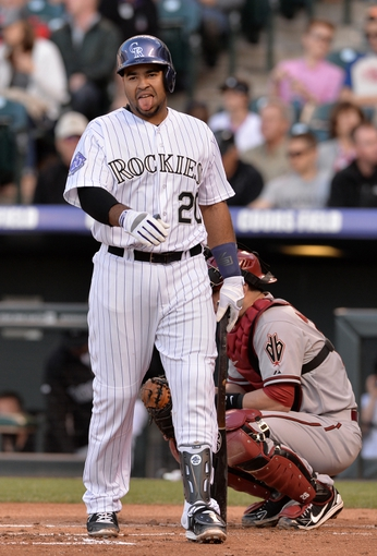 May 21, 2013; Denver, CO, USA; Colorado Rockies catcher Wilin Rosario (20) reacts after a strike called on him in the second inning against the Arizona Diamondbacks at Coors Field. Mandatory Credit: Ron Chenoy-USA TODAY Sports