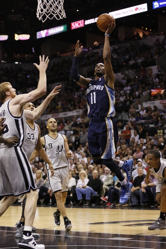 May 21, 2013; San Antonio, TX, USA; Memphis Grizzlies guard Mike Conley (11) shoots in game two of the Western Conference finals of the 2013 NBA Playoffs against the San Antonio Spurs at AT&T Center. Mandatory Credit: Soobum Im-USA TODAY Sports