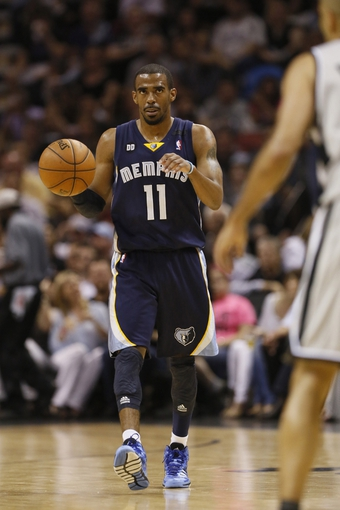 May 21, 2013; San Antonio, TX, USA; Memphis Grizzlies guard Mike Conley (11) brings the ball up court in game two of the Western Conference finals of the 2013 NBA Playoffs against the San Antonio Spurs at AT&T Center. Mandatory Credit: Soobum Im-USA TODAY Sports