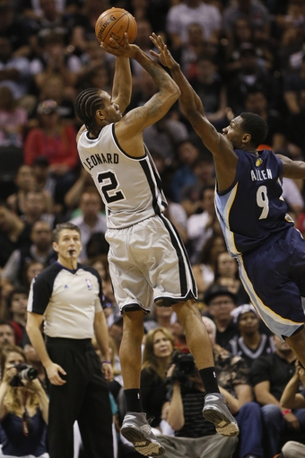 May 21, 2013; San Antonio, TX, USA; San Antonio Spurs forward Kawhi Leonard (2) takes a shot over Memphis Grizzlies guard Tony Allen (9) in game two of the Western Conference finals of the 2013 NBA Playoffs at AT&T Center. Mandatory Credit: Soobum Im-USA TODAY Sports