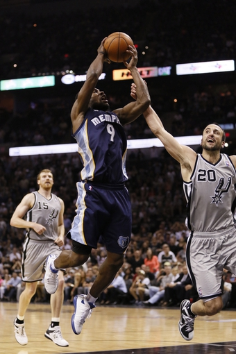 May 21, 2013; San Antonio, TX, USA; San Antonio Spurs guard Manu Ginobili (20) fouls Memphis Grizzlies guard Tony Allen (9) in game two of the Western Conference finals of the 2013 NBA Playoffs at AT&T Center. Mandatory Credit: Soobum Im-USA TODAY Sports