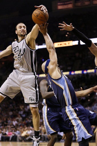 May 21, 2013; San Antonio, TX, USA; Memphis Grizzlies guard Jerryd Bayless (7) has his shot blocked by San Antonio Spurs guard Manu Ginobili (20) in game two of the Western Conference finals of the 2013 NBA Playoffs at AT&T Center. Mandatory Credit: Soobum Im-USA TODAY Sports