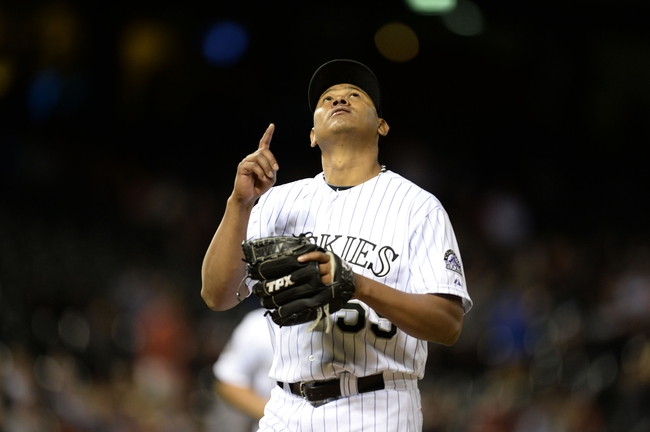 May 21, 2013; Denver, CO, USA; Colorado Rockies relief pitcher Wilton Lopez (59) reacts to a strike out in the tenth inning at Coors Field. The Rockies defeated the Diamondbacks 5-4 in tenth innings. Mandatory Credit: Ron Chenoy-USA TODAY Sports