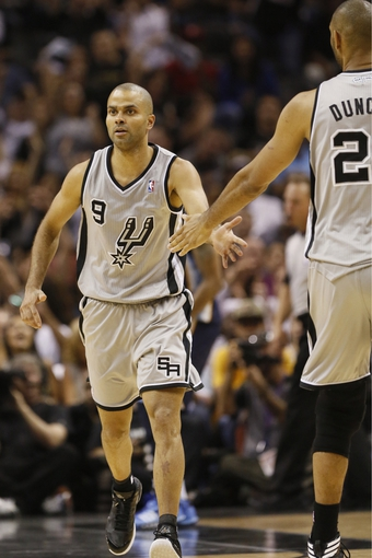 May 21, 2013; San Antonio, TX, USA; San Antonio Spurs guard Tony Parker (9) celebrates a score with forward Tim Duncan (right) in game two of the Western Conference finals of the 2013 NBA Playoffs against the Memphis Grizzlies at AT&T Center. The Spurs won 93-89. Mandatory Credit: Soobum Im-USA TODAY Sports
