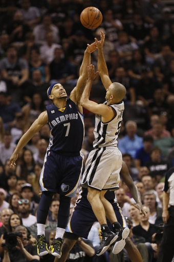 May 21, 2013; San Antonio, TX, USA; San Antonio Spurs guard Tony Parker (9) has his shot blocked by Memphis Grizzlies guard Jerryd Bayless (7) in game two of the Western Conference finals of the 2013 NBA Playoffs at AT&T Center. The Spurs won 93-89. Mandatory Credit: Soobum Im-USA TODAY Sports
