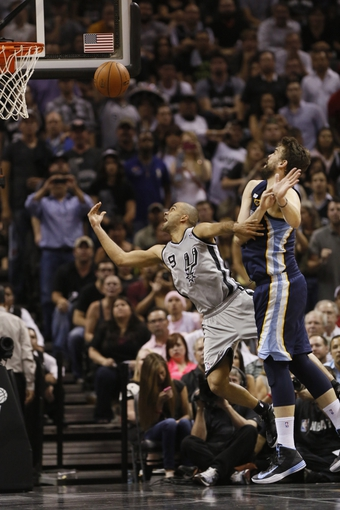 May 21, 2013; San Antonio, TX, USA; San Antonio Spurs guard Tony Parker (9) drives to the basket  past Memphis Grizzlies center Marc Gasol (33) in game two of the Western Conference finals of the 2013 NBA Playoffs at AT&T Center. The Spurs won 93-89. Mandatory Credit: Soobum Im-USA TODAY Sports