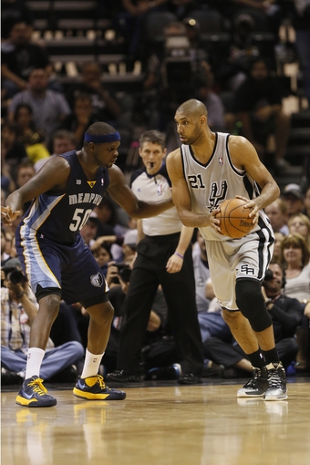 May 21, 2013; San Antonio, TX, USA; San Antonio Spurs forward Tim Duncan (21) is defended by Memphis Grizzlies forward Zach Randolph (50) in game two of the Western Conference finals of the 2013 NBA Playoffs at AT&T Center. The Spurs won 93-89. Mandatory Credit: Soobum Im-USA TODAY Sports