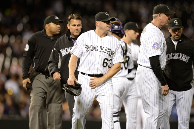 May 21, 2013; Denver, CO, USA; Colorado Rockies relief pitcher Rafael Betancourt (63) is relived of pitching after sustaining an injury against the Arizona Diamondbacks at Coors Field. The Rockies defeated the Diamondbacks 5-4 in ten innings. Mandatory Credit: Ron Chenoy-USA TODAY Sports