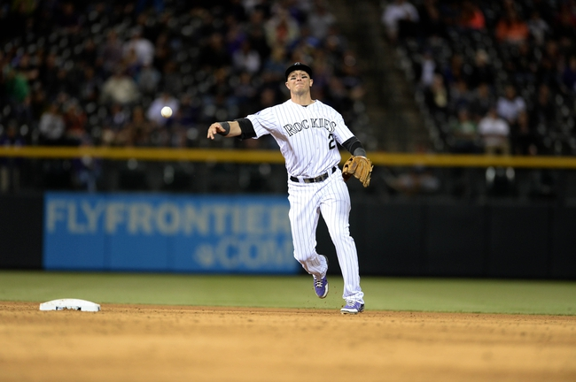 May 21, 2013; Denver, CO, USA; Colorado Rockies shortstop Troy Tulowitzki (2) throws to first base during the ninth inning against the Arizona Diamondbacks at Coors Field. The Rockies defeated the Diamondbacks 5-4 in tenth innings. Mandatory Credit: Ron Chenoy-USA TODAY Sports
