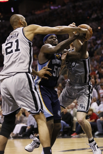 May 21, 2013; San Antonio, TX, USA; San Antonio Spurs forward Tim Duncan (21) and Memphis Grizzlies forward Zach Randolph (50) scramble for a rebound in game two of the Western Conference finals of the 2013 NBA Playoffs at AT&T Center. Mandatory Credit: Soobum Im-USA TODAY Sports