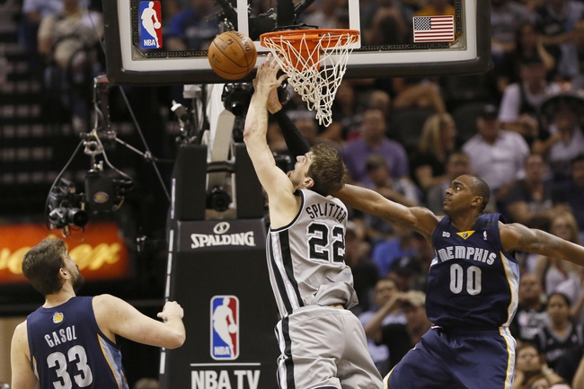 May 21, 2013; San Antonio, TX, USA; San Antonio Spurs forward Tiago Splitter (22) is fouled while driving to the basket against Memphis Grizzlies forward Darrell Arthur (00) in game two of the Western Conference finals of the 2013 NBA Playoffs at AT&T Center. Mandatory Credit: Soobum Im-USA TODAY Sports