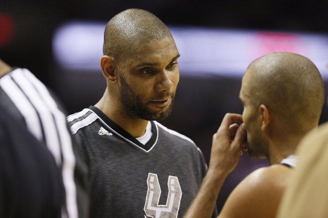 May 21, 2013; San Antonio, TX, USA; San Antonio Spurs forward Tim Duncan (left) talks with guard Tony Parker (right) in game two of the Western Conference finals of the 2013 NBA Playoffs against the Memphis Grizzlies at AT&T Center. Mandatory Credit: Soobum Im-USA TODAY Sports