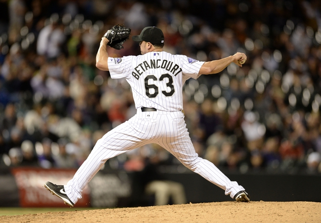 May 21, 2013; Denver, CO, USA; Colorado Rockies relief pitcher Rafael Betancourt (63) delivers a pitch against the Arizona Diamondbacks at Coors Field. The Rockies defeated the Diamondback 5-4 in ten innings. Mandatory Credit: Ron Chenoy-USA TODAY Sports