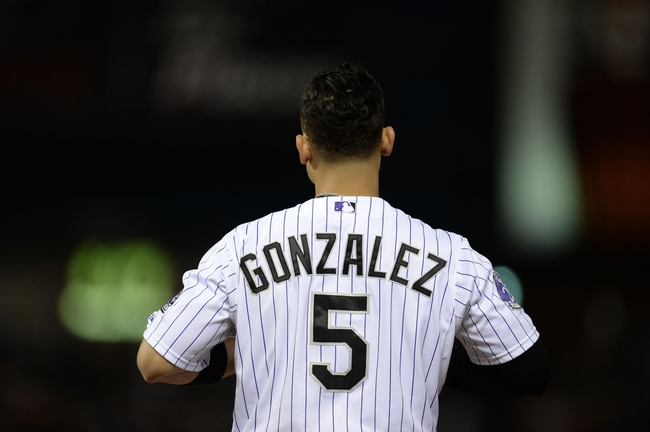 May 21, 2013; Denver, CO, USA; Colorado Rockies left fielder Carlos Gonzalez (5) during the game agains the Arizona Diamondbacks at Coors Field. The Rockies defeated the Diamondback 5-4 in ten innings. Mandatory Credit: Ron Chenoy-USA TODAY Sports