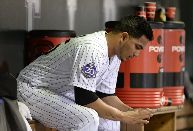 May 21, 2013; Denver, CO, USA; Colorado Rockies starting pitcher Jhoulys Chacin (45) reacts in the dugout after being pulled during the game agains the Arizona Diamondbacks at Coors Field. The Rockies defeated the Diamondback 5-4 in ten innings. Mandatory Credit: Ron Chenoy-USA TODAY Sports