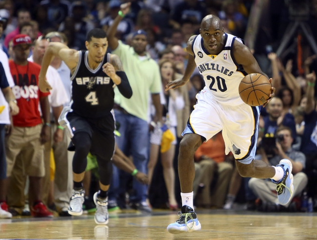 May 25, 2013; Memphis, TN, USA; Memphis Grizzlies small forward Quincy Pondexter (20) brings the ball up court in game three of the Western Conference finals of the 2013 NBA Playoffs against the San Antonio Spurs at FedEx Forum. San Antonio Spurs defeat the Memphis Grizzlies 104-93, and lead the series 3-0.  Mandatory Credit: Spruce Derden-USA TODAY Sports
