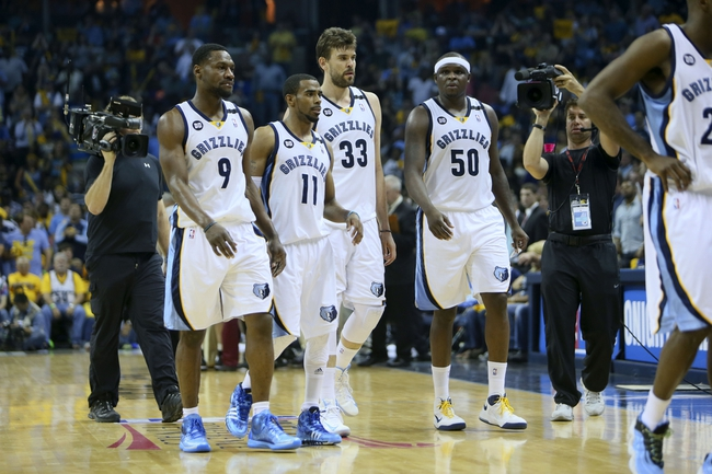 May 25, 2013; Memphis, TN, USA; Memphis Grizzlies shooting guard Tony Allen (9) Memphis Grizzlies point guard Mike Conley (11) Memphis Grizzlies center Marc Gasol (33) and Memphis Grizzlies power forward Zach Randolph (50) take a walk off the court in game three of the Western Conference finals of the 2013 NBA Playoffs against the San Antonio Spurs at FedEx Forum. San Antonio Spurs defeat the Memphis Grizzlies 104-93, and lead the series 3-0.  Mandatory Credit: Spruce Derden-USA TODAY Sports