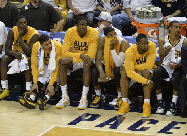 May 26, 2013; Indianapolis, IN, USA; The Indiana Pacers starters watch from the bench during the fourth quarter against the Miami Heat in game three of the Eastern Conference finals of the 2013 NBA Playoffs at Bankers Life Fieldhouse. Miami defeated Indiana 114-96.  Mandatory Credit: Jamie Rhodes-USA TODAY Sports