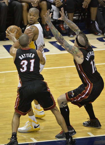 May 26, 2013; Indianapolis, IN, USA; Indiana Pacers power forward David West (21) posts up as Miami Heat small forward Shane Battier (31) and power forward Chris Andersen (11) defend during the third quarter in game three of the Eastern Conference finals of the 2013 NBA Playoffs at Bankers Life Fieldhouse. Miami defeated Indiana 114-96.  Mandatory Credit: Jamie Rhodes-USA TODAY Sports