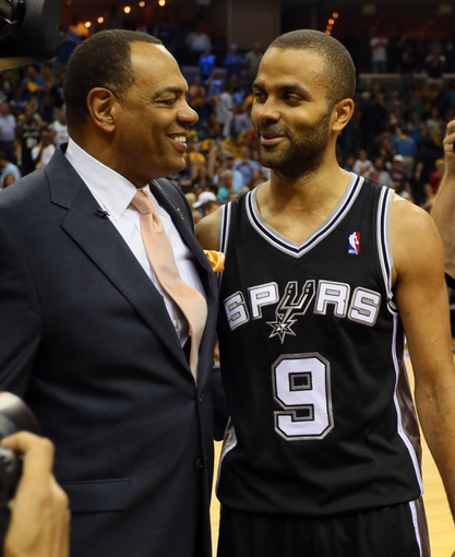 May 27, 2013; Memphis, TN, USA; Memphis Grizzlies head coach Lionel Hollins (left) talks with San Antonio Spurs point guard Tony Parker after game four of the Western Conference finals of the 2013 NBA Playoffs at FedEx Forum.  The Spurs won 93-86.  Mandatory Credit: Spruce Derden-USA TODAY Sports