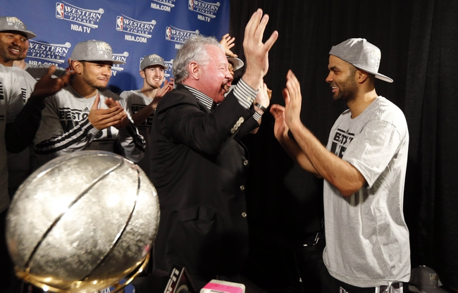 May 27, 2013; Memphis, TN, USA; San Antonio Spurs chairman Peter Holt (middle) celebrates with point guard Tony Parker (right) in the locker room after game four of the Western Conference finals of the 2013 NBA Playoffs against the Memphis Grizzlies at FedEx Forum.  The Spurs won 93-86.  Mandatory Credit: Rogelio V. Solis/Pool Photo-USA TODAY Sports