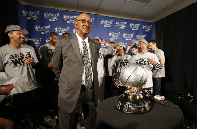 May 27, 2013; Memphis, TN, USA; San Antonio Spurs former player George Gervin stands with current Spurs players and the Western Conference championship trophy after game four of the Western Conference finals of the 2013 NBA Playoffs against the Memphis Grizzlies at FedEx Forum.  The Spurs won 93-86.  Mandatory Credit: Rogelio V. Solis/Pool Photo-USA TODAY Sports