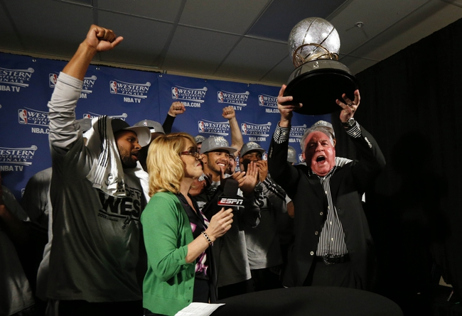 May 27, 2013; Memphis, TN, USA; San Antonio Spurs chairman Peter Holt hoists the Western Conference championship trophy in the locker room after game four of the Western Conference finals of the 2013 NBA Playoffs against the Memphis Grizzlies at FedEx Forum.  The Spurs won 93-86.  Mandatory Credit: Rogelio V. Solis/Pool Photo-USA TODAY Sports
