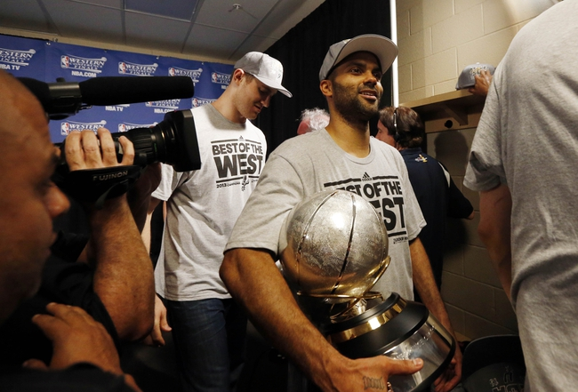May 27, 2013; Memphis, TN, USA; San Antonio Spurs point guard Tony Parker leaves the locker room with the Western Conference championship trophy after game four of the Western Conference finals of the 2013 NBA Playoffs against the Memphis Grizzlies at FedEx Forum.  The Spurs won 93-86.  Mandatory Credit: Rogelio V. Solis/Pool Photo-USA TODAY Sports