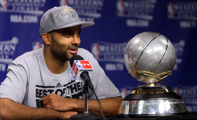 May 27, 2013; Memphis, TN, USA; San Antonio Spurs point guard Tony Parker speaks at a press conference after game four of the Western Conference finals of the 2013 NBA Playoffs against the Memphis Grizzlies at FedEx Forum.  The Spurs won 93-86.  Mandatory Credit: Spruce Derden-USA TODAY Sports