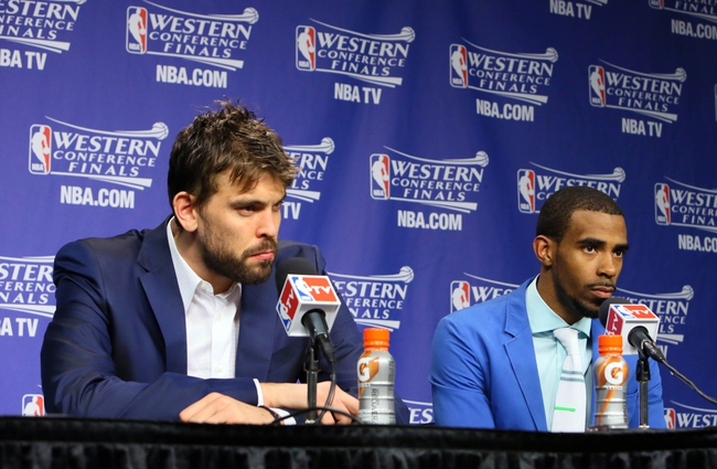 May 27, 2013; Memphis, TN, USA; Memphis Grizzlies center Marc Gasol (left) and point guard Mike Conley (right) at a press conference after game four of the Western Conference finals of the 2013 NBA Playoffs against the San Antonio Spurs at FedEx Forum.  The Spurs won 93-86.  Mandatory Credit: Spruce Derden-USA TODAY Sports