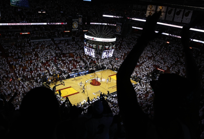 Jun 3, 2013; Miami, FL, USA; Miami Heat fans celebrate at the end of game 7 of the 2013 NBA Eastern Conference Finals at American Airlines Arena. Miami Heat defeated the Indiana Pacers 99-76 to win the series 4 games to 3 . Mandatory Credit: Robert Mayer-USA TODAY Sports