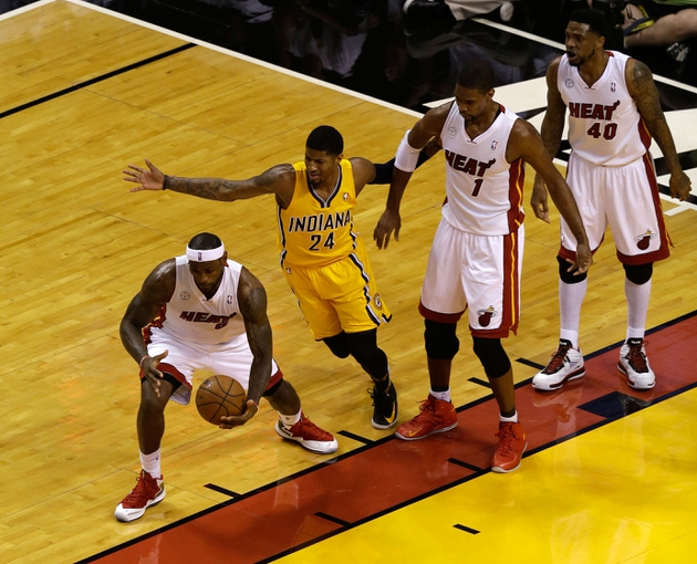 Jun 3, 2013; Miami, FL, USA;  Miami Heat small forward LeBron James (6) grabs a loose ball in front of Indiana Pacers small forward Paul George (24) Heat center Chris Bosh (1) and power forward Udonis Haslem (40) during the first quarter of game 7 of the 2013 NBA Eastern Conference Finals at American Airlines Arena. Mandatory Credit: Robert Mayer-USA TODAY Sports
