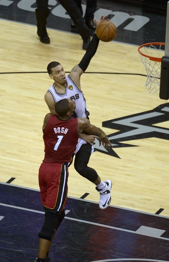 Jun 11, 2013; San Antonio, TX, USA; San Antonio Spurs shooting guard Danny Green (4) shoots over Miami Heat center Chris Bosh (1) in the third quarter during game three of he 2013 NBA Finals at the AT&T Center. Mandatory Credit: Brendan Maloney-USA TODAY Sports